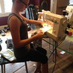 My niece sewing on the parts