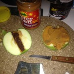 Apple Filled with PB and Chocolate and some PB spread across the apple