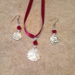 Earrings and matching flower necklace set using ribbon for the necklace.